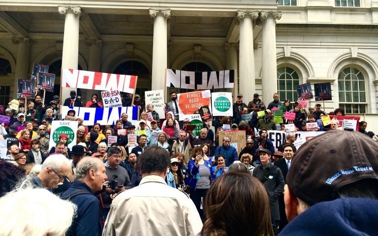 A crowd gathers at the steps of City Hall to oppose the Mayor's approach to affordble housing.